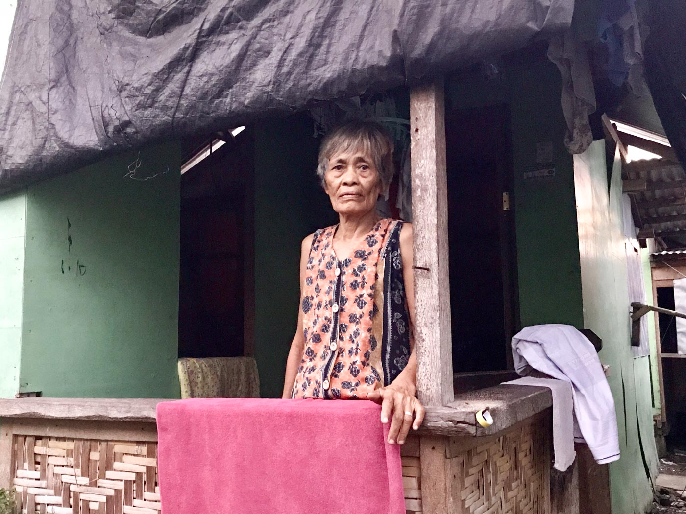 WAITING. Priscilla Mia, 73, lost her daughter and her grandchild to Yolanda. She lives with her other grandchildren in a bunkhouse in Costa Brava, San Jose. She feels neglected because her promised permanent house in the north of Tacloban remains unfulfilled. Photo by Jene-Anne Pangue