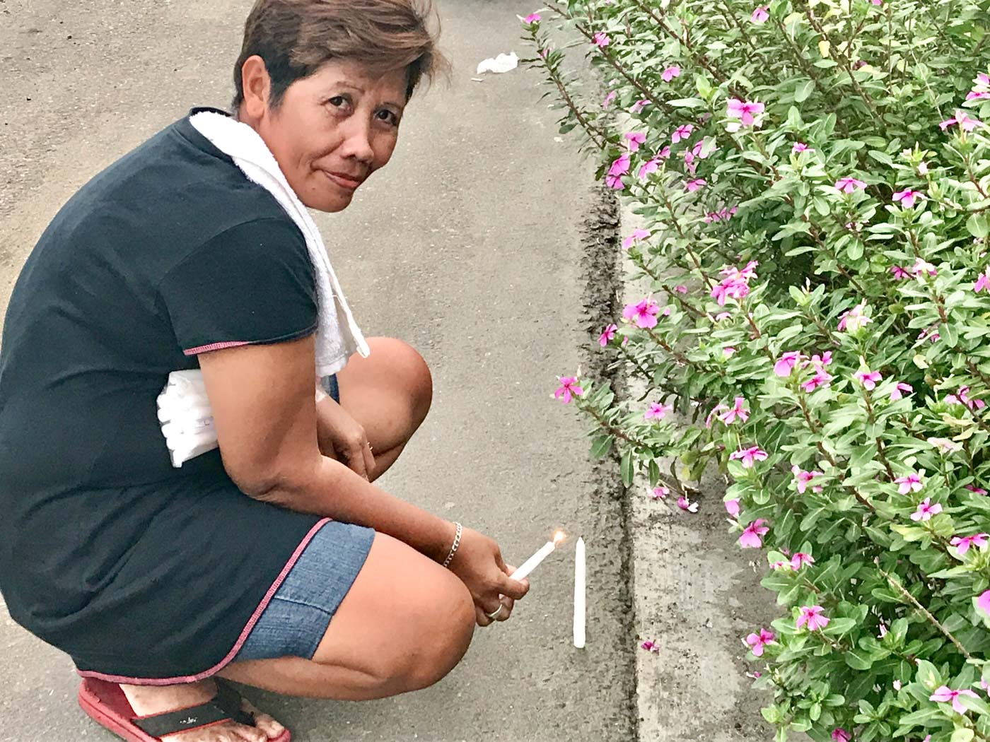 HOPE STILL REMAINS. Analyn Pajares, 43, is a resident of Barangay 88 San Jose. She lights a candle for her sibling who has yet to be found since Super Typhoon Yolanda. She has not lost hope that someday, her sibling will come home. Photo by Jene-Anne Pangue