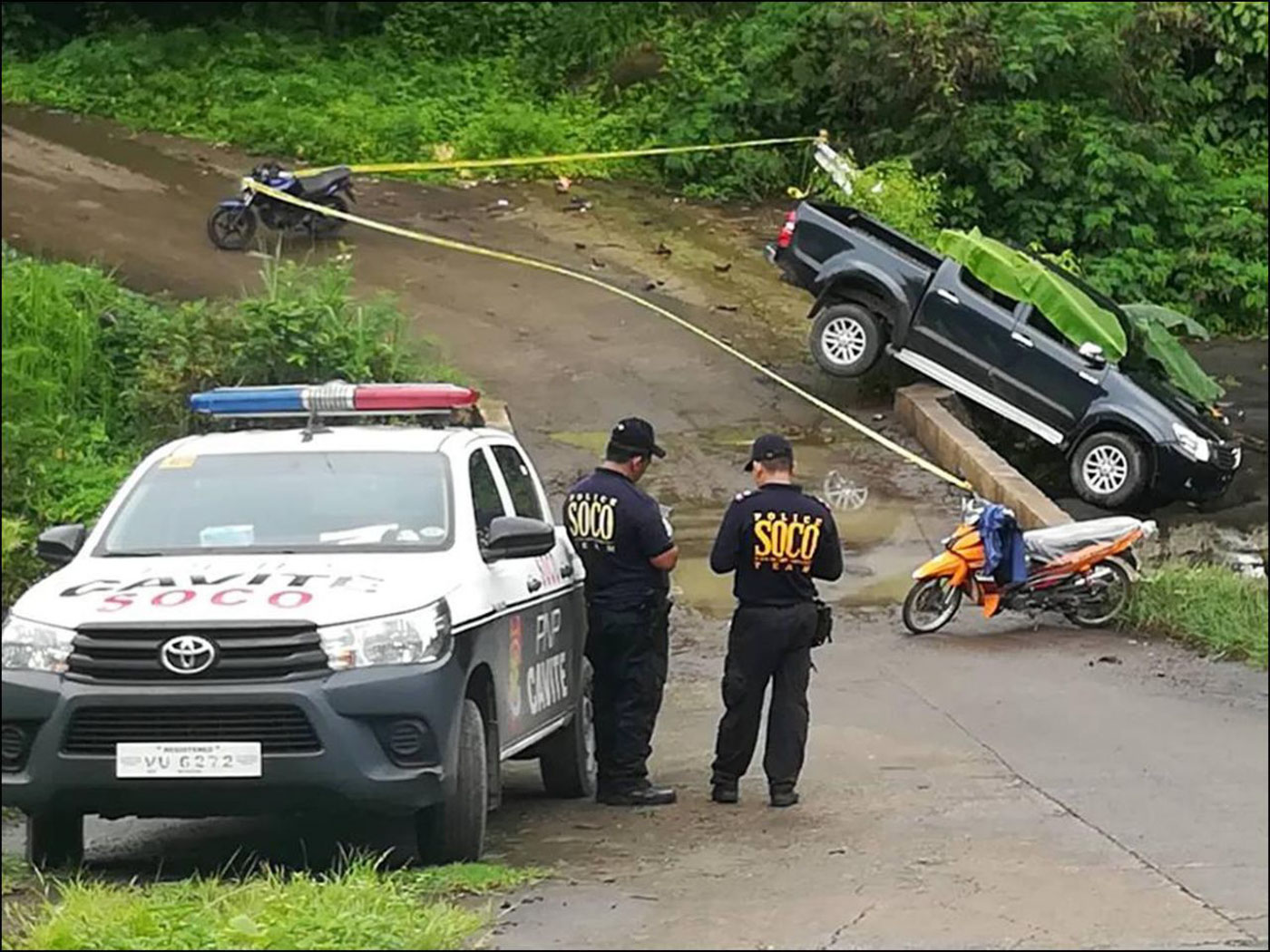 RECOVERED. Police inspect the area where the vehicle was abandoned. PNP photo