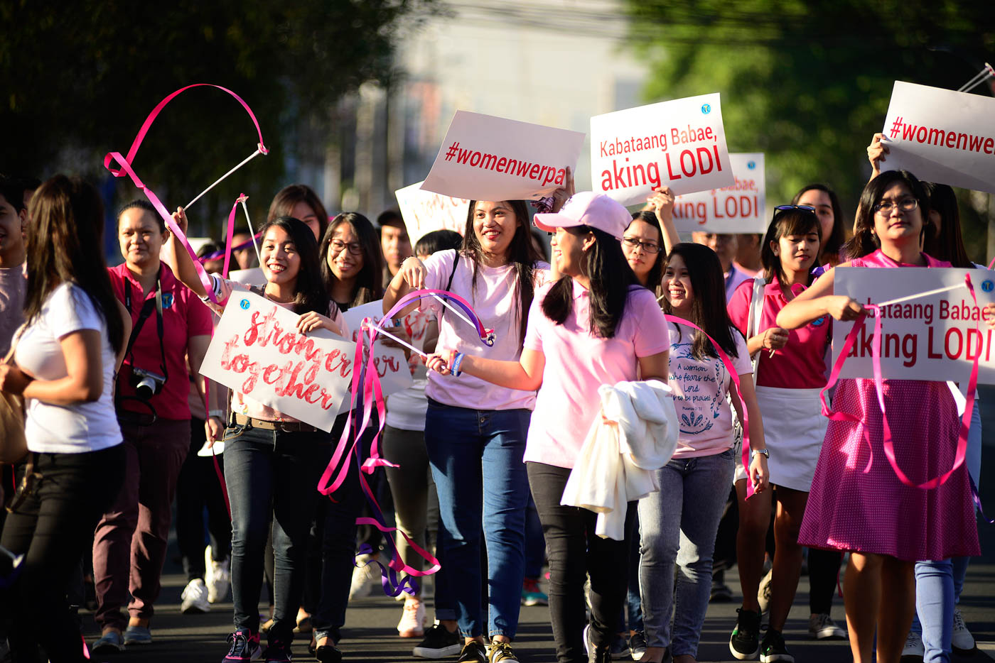 EMPOWERING WOMEN. NYC youth volunteers and workers march along West Avenue in Quezon City in celebration of women's month. Photo by Maria Tan/Rappler