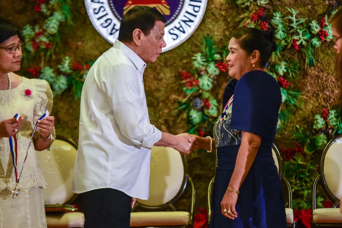 President Rodrigo Duterte with team leader Romana Basalan
