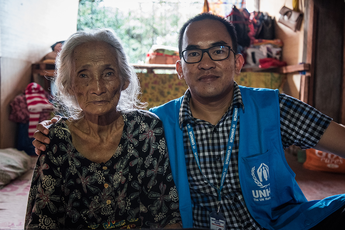 HUMANITARIAN EFFORTS. A UNHCR humanitarian worker spends the afternoon at a community-based evacuation camp with babo (grandmother) HajaJijarah Manunggad, who is believed to be over 100 years old. Photo by Alecs Ongcal/UNHCR