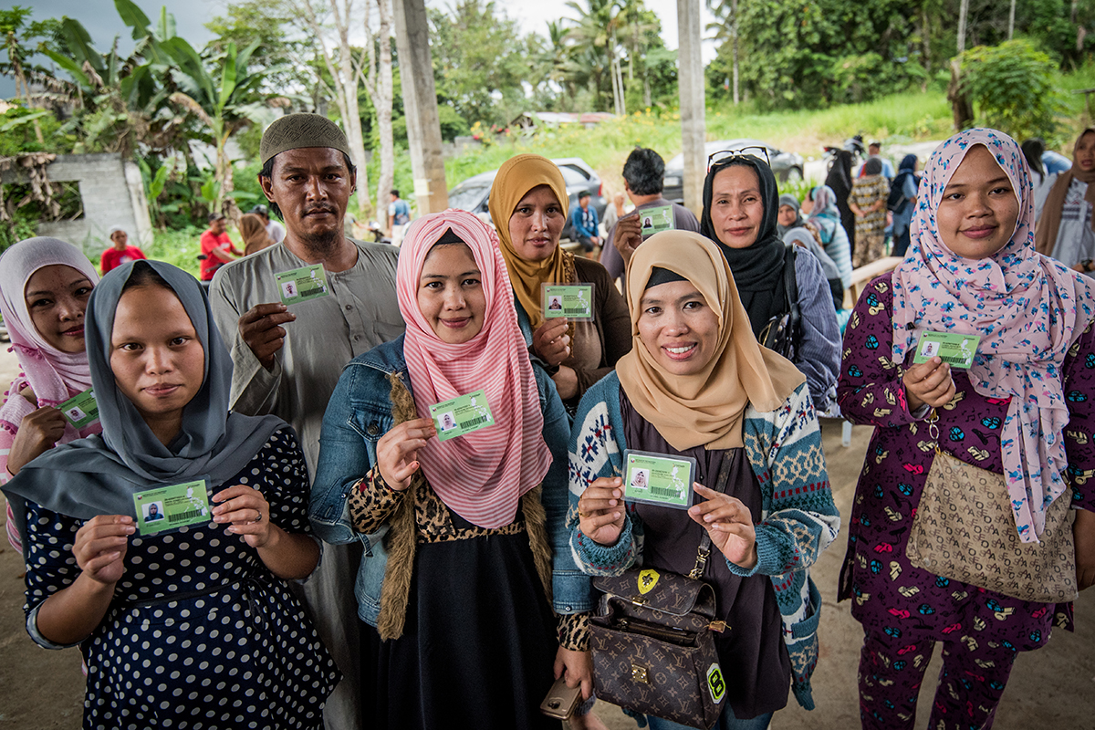 IDENTITY. Tens of thousands of families who fled Marawi City at the height of the armed conflict in May 2017 were unable to bring with them legal documents and identification cards, limiting their freedom to move and making them vulnerable to abuse. UNHCR continues to work with its partners to provide PhilHealthID cards to those who were affected by the conflict. In December 2017, about 1,200 heads of families from Marawi's Barangays Basak Malutlut and Matampay received their IDs, restoring their right to freedom of movement. To date, more than 9,000 IDs have been distributed. Photo by Alecs Ongcal/UNHCR