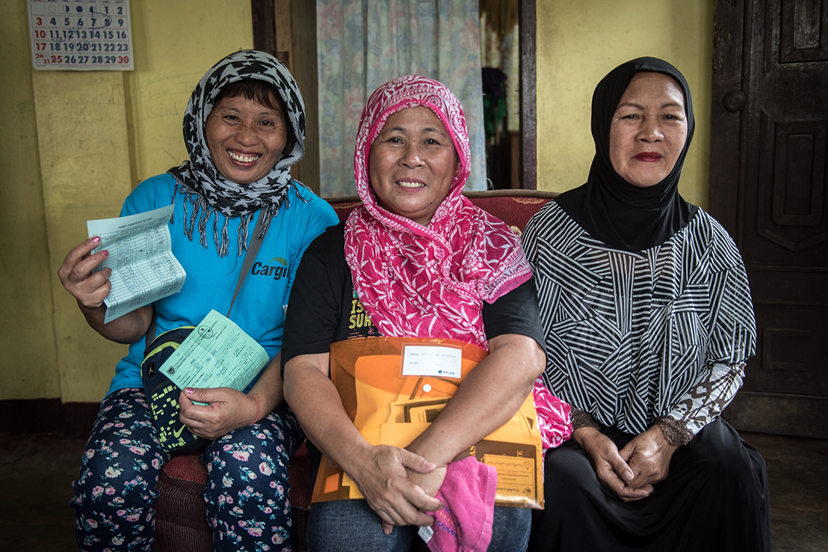 BACK HOME. Arcelie Baldoviso, Arlene Orcilino, and Norjana Taurak sought shelter in various evacuation camps in Iligan City while the fighting in Marawi City was ongoing. They have returned home in November 2017. They are grandmothers and breadwinners of their families. Photo by Alecs Ongcal/UNHCR