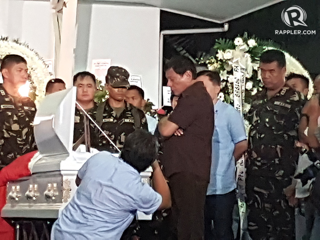 NPA ATTACK. President Rodrigo Duterte visits the wake of 4 soldiers slain in attacks launched by the New People's Army. Photo by Editha Caduaya/Rappler
