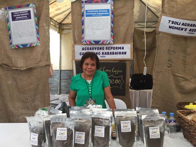 HAND MADE. Nay Conching from Davao Oriental proudly displays her very own Coconut Corn Coffee at the Women's Market - a marketplace of homegrown and handcrafted merchandise. Photo by Denise Nacnac/Rappler