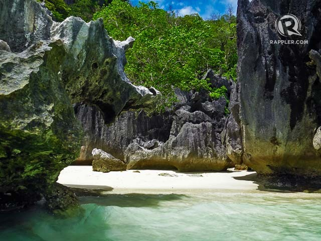 SAND AND ROCKS. Many of Coron's white beaches have beautiful rock formations