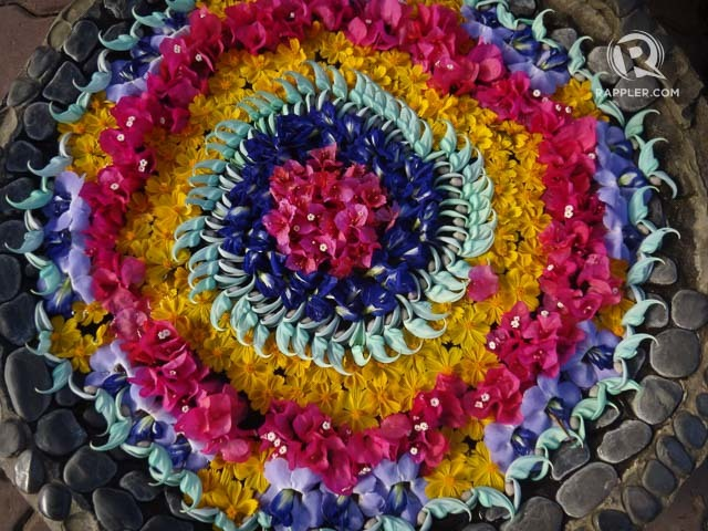 BURSTS OF COLOR. Baker's Hill has several flower art displays like this, and even stone mosaic art