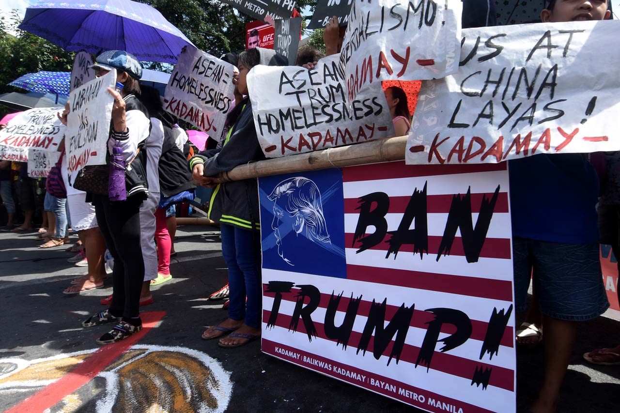 NOT WELCOME. Ahead of the gathering of world leaders in Metro Manila for the ASEAN summit, militant groups stage a series of protests on November 10, 2017. Photo by Angie de Silva/Rappler