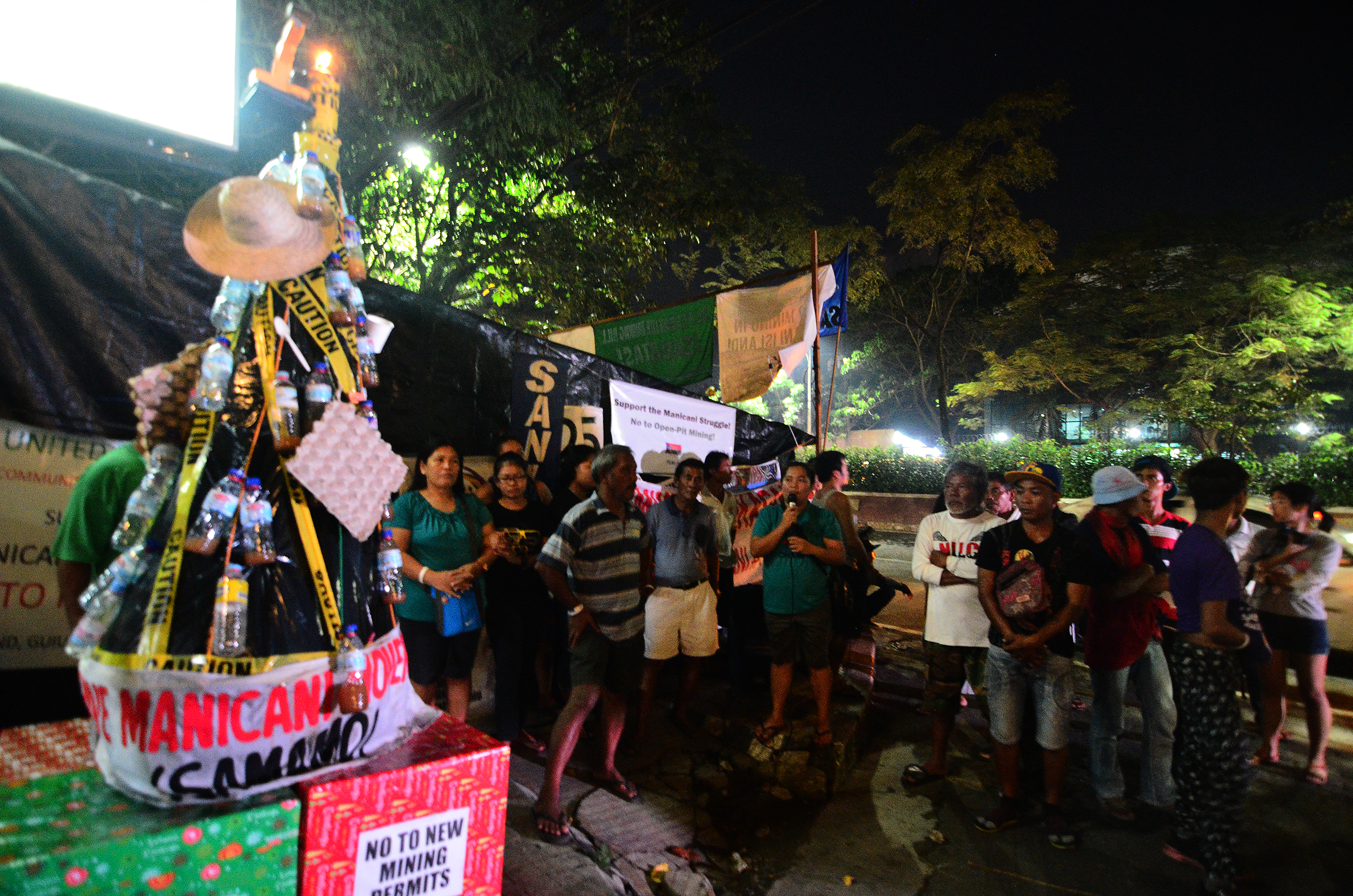 PROTEST. Residents of Manicani, Eastern Samar and Sta. Cruz Zambales all calling for an end of the open pit mining activities in their respective communities. Photo by Maria Tan/Rappler