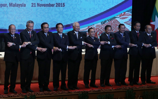 ASEAN SOLIDARITY. Philippine President Benigno Aquino III links arms with fellow ASEAN leaders during the 27th ASEAN Summit and Related Summits at the Plenary Theater of the Kuala Lumpur Convention Centre on November 21, 2015. Photo by Gil Nartea/Malacañang Photo Bureau
