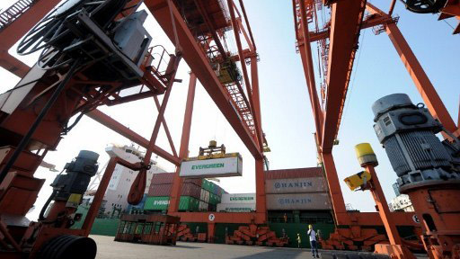 TRADE LOGISTICS. Cranes at work in a Philippine port. Photo by AFP