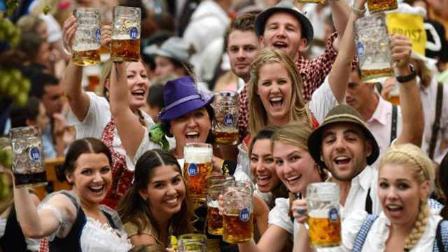 CHEERS. Visitors wearing traditional Bavarian clothes raise their beers in a festival tent at the start of the Oktoberfest beer festival at the Theresienwiese in Munich, southern Germany. The world's biggest beer festival Oktoberfest will run until October 7, 2012. Photo by AFP