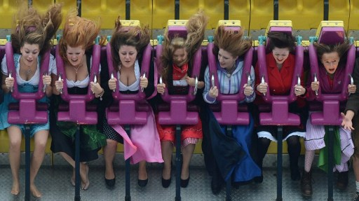 WILD SWINGS. Visitors wearing traditional Bavarian ride a fairground ride at the Oktoberfest beer festival at the Theresienwiese in Munich, southern Germany. Photo by AFP