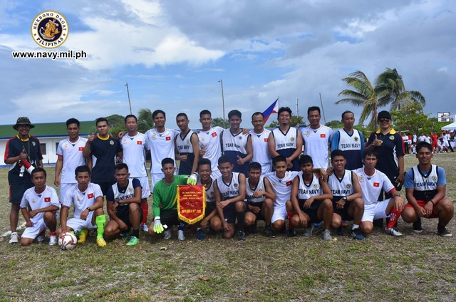 COMRADES. The members of the Philippine and Vietnam navies which played games volleyball on disputed island. Photo courtesy of Philippine Navy