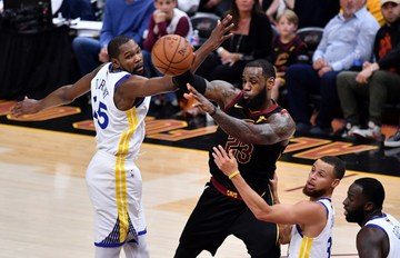 a4934c1b1507 SUPERSTAR DUEL. Cavs  LeBron James throws a pass around Warriors  Steph  Curry and