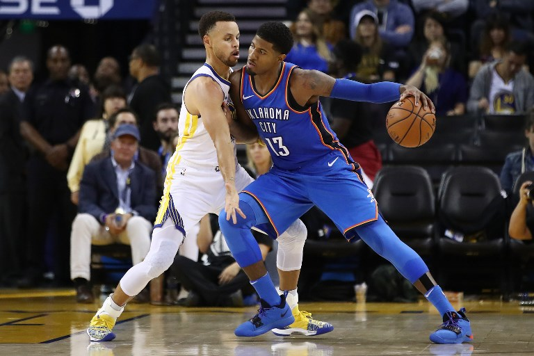 50d205caa0e5 OKC s Paul George drives with the ball against Golden State s Stephen Curry  during their NBA opening