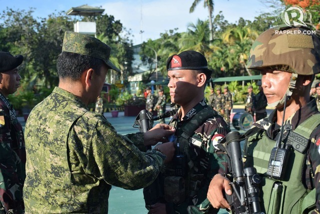 AWARDING. Members of the 5th Scout Ranger Battalion are given Gold Cross Medals at a ceremony on February 5, 2018. Photo by Richard Falcatan/Rappler