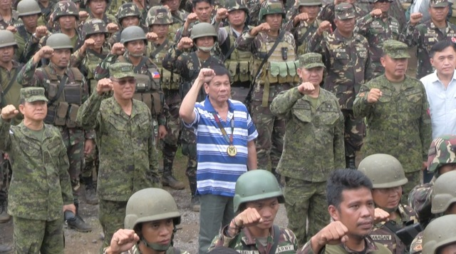TROOP VISIT. President Rodrigo Duterte visits troops running after the Maute Group in Butig, Lanao del Sur in November 2016. Photo by Carmela Fonbuena/Rappler