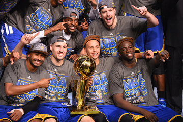 3588f7adaca Stephen Curry (C-R) and Klay Thompson (C-L) along with other members of