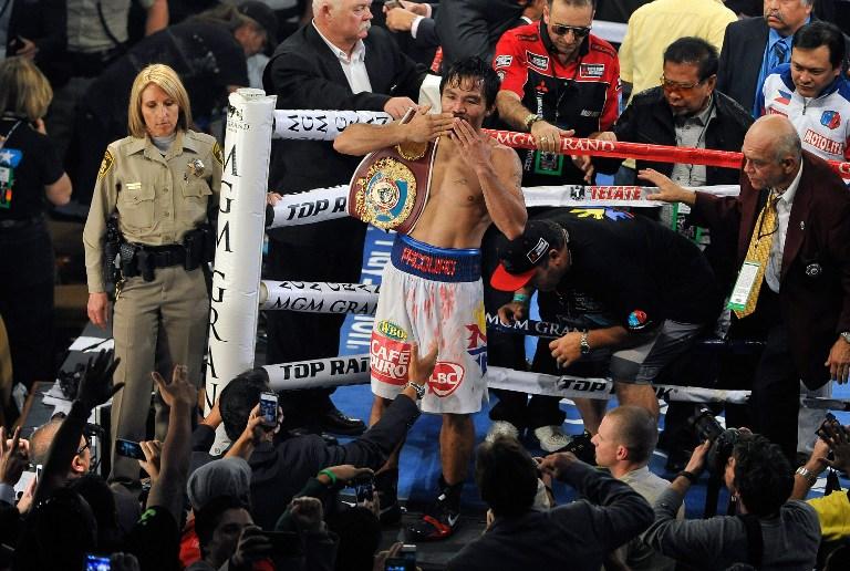 Pacquiao shows warrior's heart in Bradley win