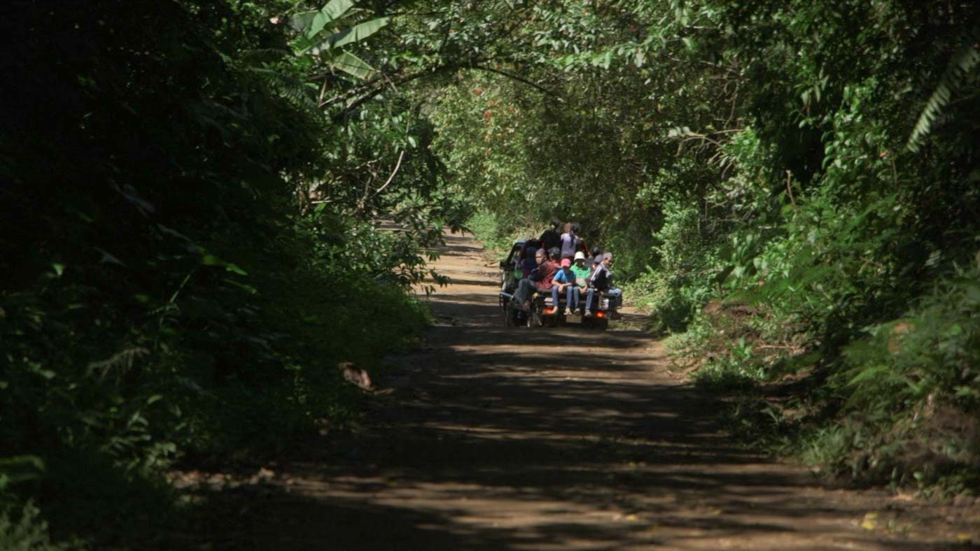 LACK OF CONCRETE ROADS. Children riding a small truck pass through rough roads in Binidayan. Photo by Adrian Portugal/Rappler