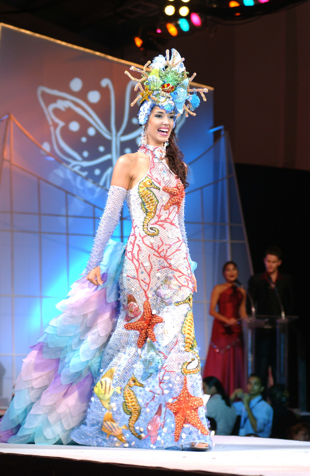 Amelia Vega, Miss Dominican Republic 2003, walks the runway after winning the 2003 Miss Universe National Costume show at the El Panama Hotel in Panama City, Panama. Photo from the Miss Universe Organization