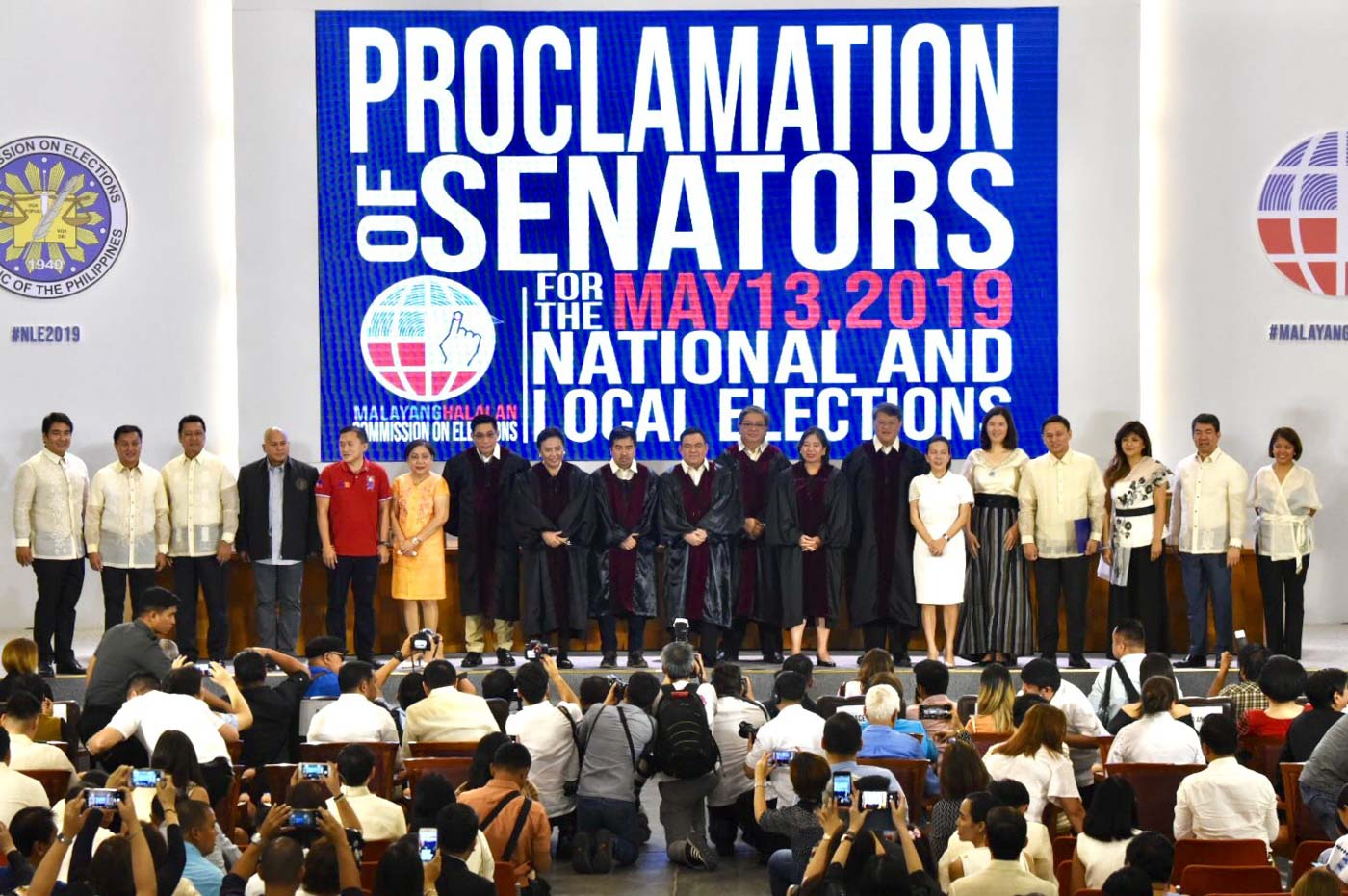 WINNING senators pose with the 7 members of the Commission on Elections after their proclamation on May 22, 2019. Photo by Angie de Silva/Rappler