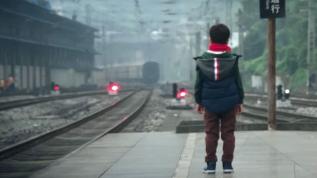 WAITING GAME. A boy waits for his mother in this screenshot from '3 Minutes,' a short film shot on an iPhone X. Screenshot from Apple/YouTube