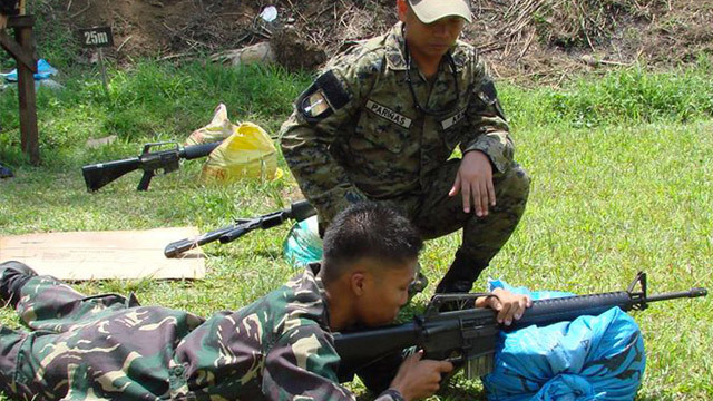 REQUIRED SOON? A soldier of the 1st Scout Ranger Regiment of the Philippine Army instructs an ROTC cadet officer on the finer points of the M16 rifle. Photo from Wikipedia