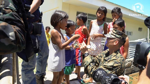 EDUCATION TOO. A US Navy man teaches Casiguran children how to use a stethoscope. Photo by Jeff Digma/Rappler