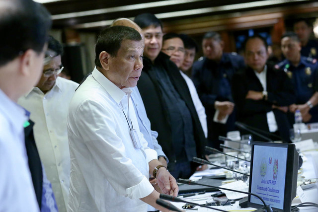 NO TO GERMS. The device around President Duterte's neck is described as an 'air purifier' to protect him from air-borne germs. Malacañang photo