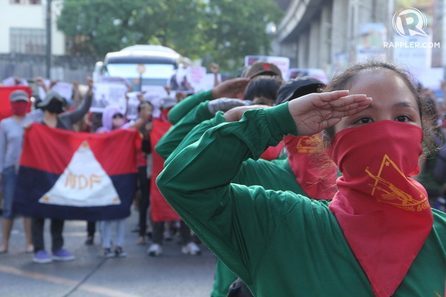 GUERRILLAS IN THE METRO. Communist rebels stage a rally on March 27, 2017, in Quezon City, before their March 29 founding anniversary. Photoby Romeo Mariano/Rappler