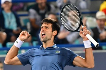 f82b8b1be Novak Djokovic celebrates his victory over Kevin Anderson at the Mubadala  World
