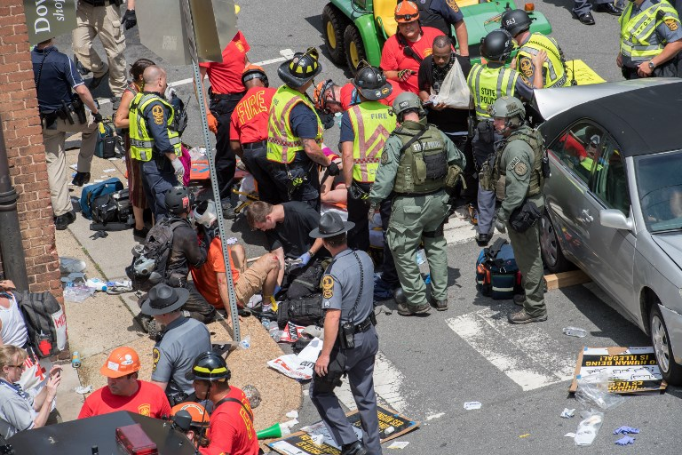 Car, helicopter crashes claim 3 lives at U.S. far-right rally