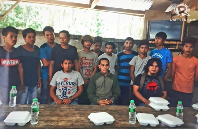 SURRENDER.  Abu Sayyaf Group  sub leader in Basilan Nhurhassan Jamiri (seated, center) and his 13 followers surrender to government forces Wednesday at Barangay Sirongon , Mohammad Adjul. Photo by Richard Falcatan