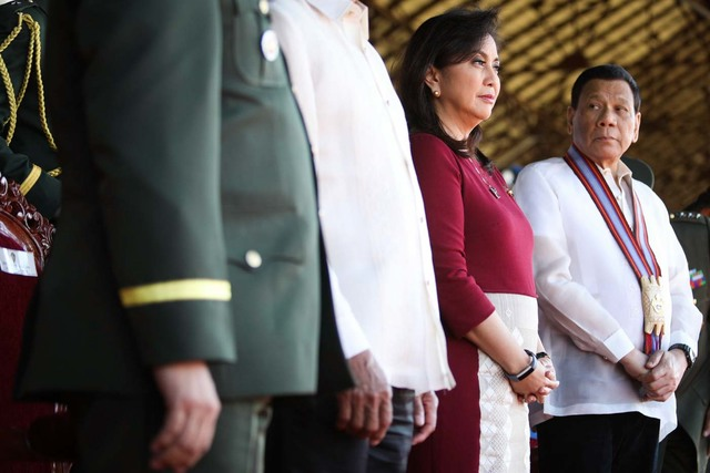 WORKING TOGETHER. Vice President Leni Robredo is greeted by President Rodrigo Duterte at the graduation rites of PMA Alab-Tala Class of 2018, at Fort del Pilar, Baguio City on Sunday, March 18, 2017. Photo by OVP