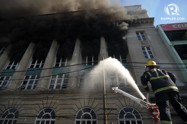 FIRE AT THE NATIONAL ARCHIVES. Firefighters try to extinguish a fire engulfing a building in Binondo, Manila on May 28. Photo by Ben Nabong/Rappler