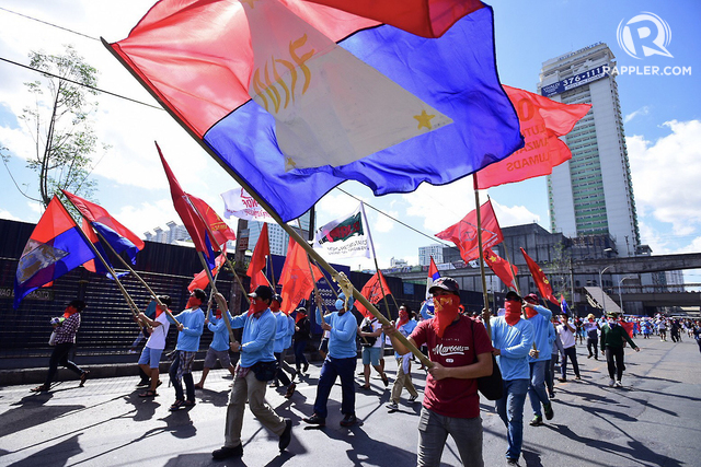 LIGHTNING RALLY. Supporters of the National Democratic Front Philippines march along Aurora Blvd. in Cubao, Quezon City on April 23, 2018, to mark the 45th anniversary of the revolutionary front. All photos by Maria Tan, DarrenLangit/Rappler