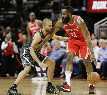5a8ffed0c James Harden  13 of the Houston Rockets holds off Tony Parker  9