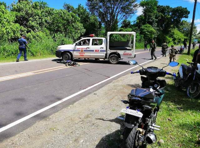 CRIME SCENE. The tailing police vehicle accompanying the convoy of Food and Drug Administration chief Nela Charade Puno is barraged with bullets. Photo from Bicol Police