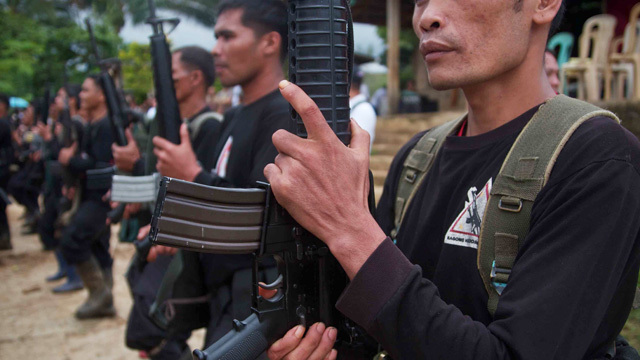 THE CAUSE. New People's Army fighters in Mindanao. File photo by Karlos Manlupig