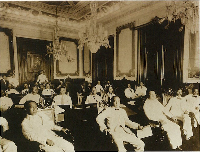100TH ANNIVERSARY. The Senate of the Philippines with Manuel L. Quezon (back of the room) presiding, in the Marble Hall of the Ayuntamiento de Manila. Photo from the Official Gazette of the Philippines
