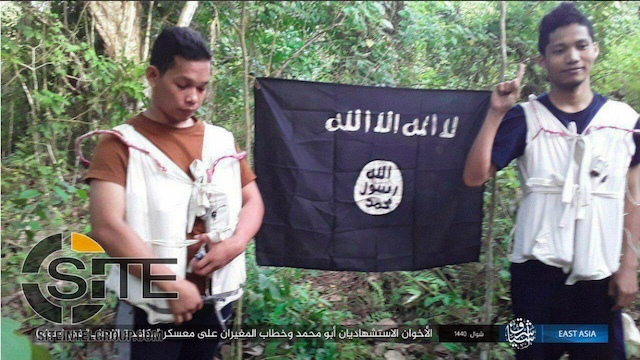SUICIDE BOMBERS? ISIS has claimed responsibility for the twin bombings on a military camp in Sulu, supposedly carried out by these two Abu Sayyaf affiliates. Screengrab from Twitter page of Rita Katz