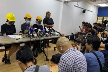 Masked Hong Kong protesters hold rare press conference