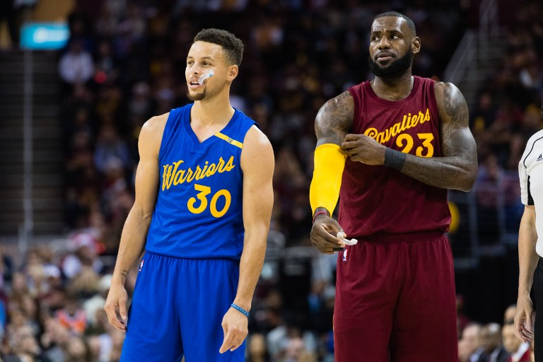 CAPPED. Stephen Curry (L) and LeBron James (R) of the Golden 00240b2cf