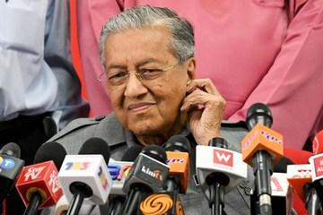 Malaysia issues arrest warrant for financier over 1MDB scandal