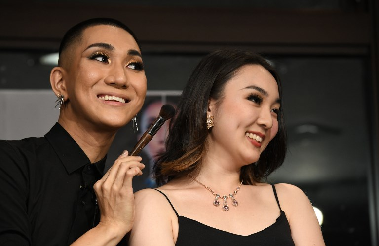 LGBT MONK. In this photo taken on July 19, 2018 Japanese make-up artist and Buddhist monk Kodo Nishimura (left) poses with model Yuri Hotta during the talk session at the Waseda University in Tokyo. 