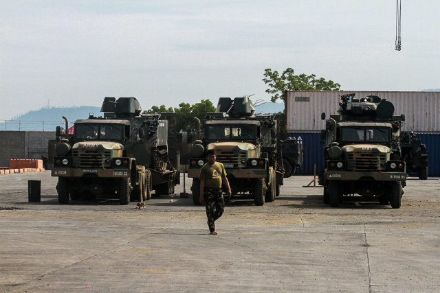 MILITARY HARDWARE. Additional vehicles being unloaded from the BRP Davao del Sur on August 3. Photo by Bobby Lagsa/Rappler