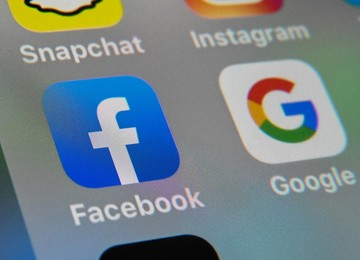 Australia stops short of major clampdown on Facebook, Google